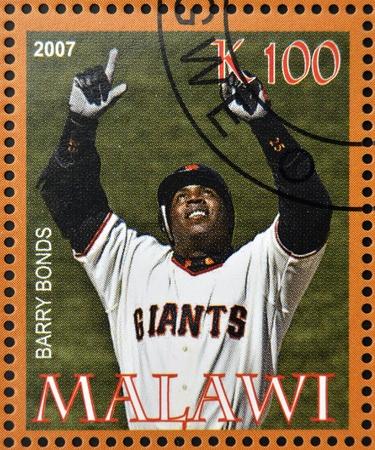 sportman: MALAWI - CIRCA 2007: A stamp printed in Malawi dedicated to greatest baseball players, shows Barry Bonds, circa 2007  Editorial