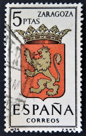 SPAIN - CIRCA 1965: A stamp printed in Spain dedicated to Arms of Provincial Capitals shows Zaragoza, circa 1965.  Stock Photo - 20552873