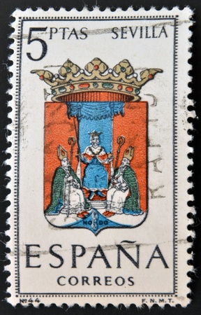 SPAIN - CIRCA 1965: A stamp printed in Spain dedicated to Arms of Provincial Capitals shows Seville, circa 1965.  Stock Photo - 20552857