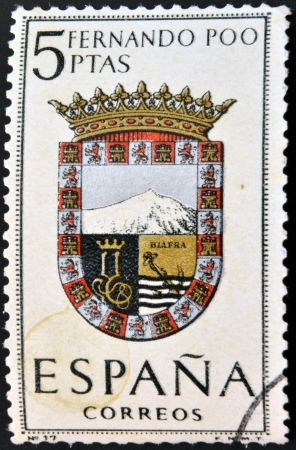 poo: SPAIN - CIRCA 1965: A stamp printed in Spain dedicated to Arms of Provincial Capitals shows Fernando Poo, circa 1965.  Editorial