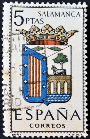 SPAIN - CIRCA 1965: A stamp printed in Spain dedicated to Arms of Provincial Capitals shows Salamanca, circa 1965.  Stock Photo - 20552871