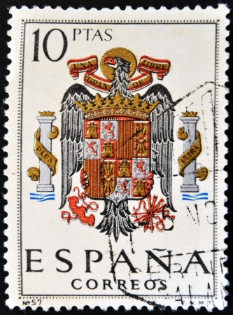 dictatorship: SPAIN - CIRCA 1965: A stamp printed in Spain shows shield of Spain during the Franco dictatorship, circa 1965.