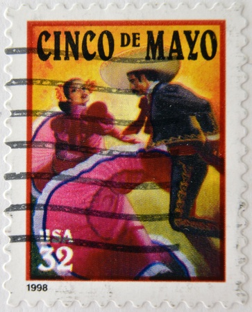 UNITED STATES OF AMERICA - CIRCA 1998: A stamp printed in USA shows salute to the holiday Cinco de Mayo, circa 1998