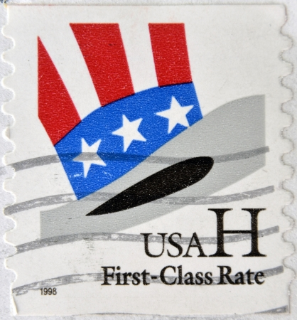 enlisting: UNITED STATES OF AMERICA - CIRCA 1998: A stamp printed in USA shows Uncle Sams Hat, circa 1998