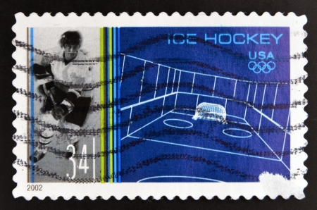 UNITED STATES OF AMERICA - CIRCA 2002: A stamp printed in USA  shows ice hockey, circa 2002 Stock Photo - 20552840