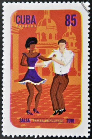 woman dancing: CUBA - CIRCA 2010  A stamp printed in Cuba dedicated to popular dances, shows salsa dance, circa 2010