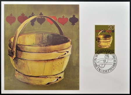 LIECHTENSTEIN - CIRCA 1980  A stamp printed in Liechtenstein dedicated to old alpine dairy farming implements shows Milking Pail, circa 1980