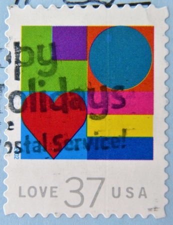 faithfulness: UNITED STATES OF AMERICA- CIRCA 2002: A stamp printed in USA shows hearts, love, circa 2002