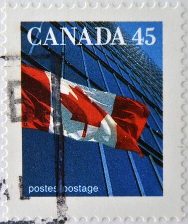 CANADA - CIRCA 1995: A stamp printed in Canada shows image of a the Canadian flag and a modern building, circa 1995
