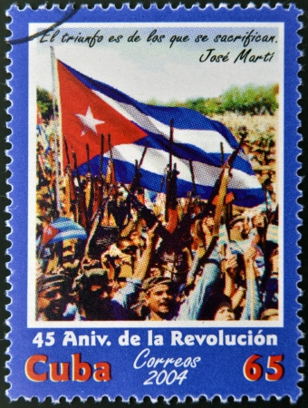 CUBA - CIRCA 2004: A stamp printed in Cuba commemorating the 45th anniversary of the Revolution, circa 2004