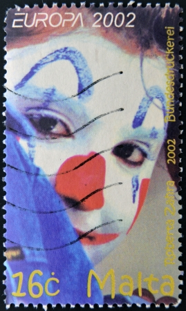 MALTA - CIRCA 2002: A stamp printed in Malta shows image of a clown, circa 2002