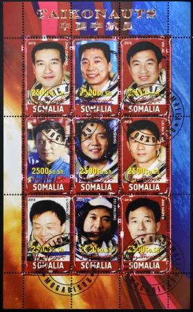 chinese postage stamp: SOMALIA - CIRCA 2010: stamps printed in somalia dedicated to taikonaut, circa 2010