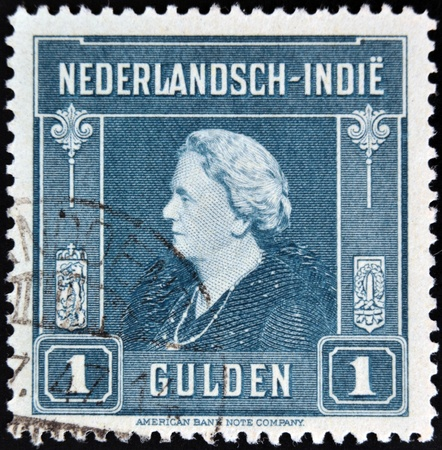 wilhelmina: DUTCH EAST INDIES - CIRCA 1945: A stamp printed in the Netherlands Indies shows image of Queen Wilhelmina of the Netherlands, circa 1945