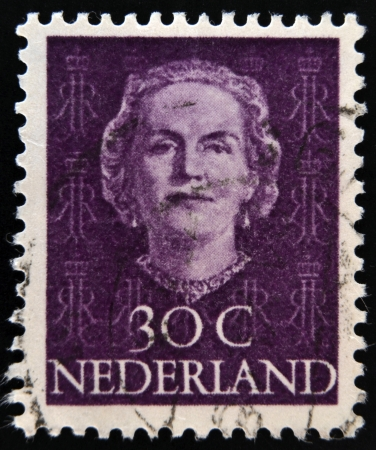 regnant: NETHERLANDS - CIRCA 1970: A stamp printed in the Holland shows image of Queen Juliana, circa 1970