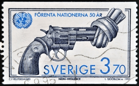non violence: SWEDEN - CIRCA 1995: A stamp printed in Sweden shows Image of Non Violence sculpture by Fredrik Reutersward, circa 1995
