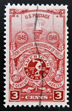 turner: USA - CIRCA 1948  Stamp printed in USA shows the Torch and American Turner