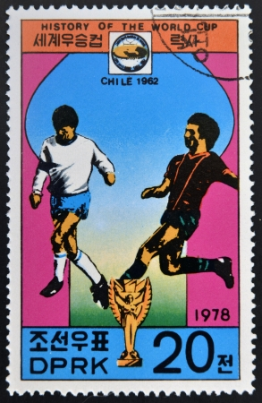 glob: KOREA - CIRCA 1978: A Stamp printed in North Korea shows the Soccer players, Cup and Glob with the inscription Chile, 1962, from the series History of World Cup Football Championship, circa 1978