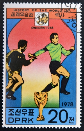 KOREA - CIRCA 1978: A Stamp printed in North Korea shows the Soccer players, Cup and Glob with the inscription Sweden, 1958, from the series History of World Cup Football Championship, circa 1978