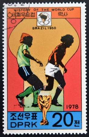 glob: KOREA - CIRCA 1978: A Stamp printed in North Korea shows the Soccer players, Cup and Glob with the inscription Brazil, 1950, from the series History of World Cup Football Championship, circa 1978
