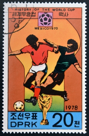 glob: KOREA - CIRCA 1978: A Stamp printed in North Korea shows the Soccer players, Cup and Glob with the inscription Mexico, 1970, from the series History of World Cup Football Championship, circa 1978