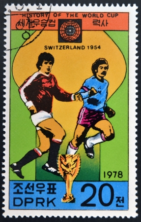 glob: KOREA - CIRCA 1978: A Stamp printed in North Korea shows the Soccer players, Cup and Glob with the inscription Switzerland, 1954, from the series History of World Cup Football Championship, circa 1978  Editorial