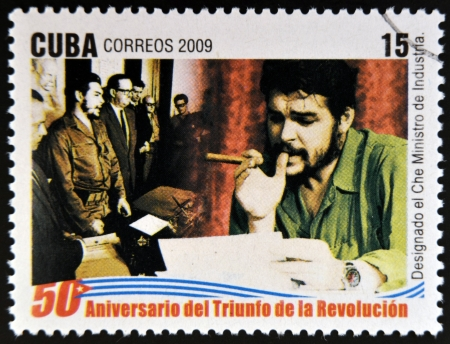 appointed: CUBA - CIRCA 2009: A stamp printed in cuba dedicated to 50 anniversary of the triumph of the revolution, shows Che appointed Minister of Industry, circa 2009