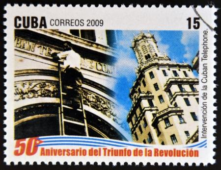 interventie: CUBA - CIRCA 2009: Een stempel gedrukt in Cuba gewijd aan 50-jarig bestaan van de triomf van de revolutie, toont Cubaanse Telefoon Intervention, circa 2009