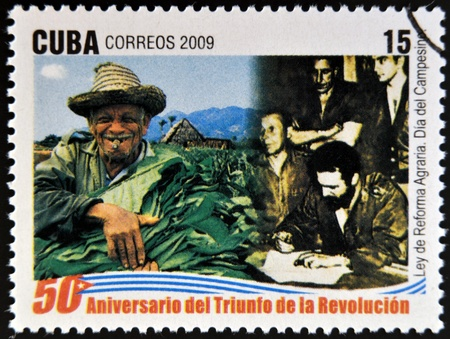 agrarian: CUBA - CIRCA 2009: A stamp printed in cuba dedicated to 50 anniversary of the triumph of the revolution, shows agrarian reform law, Farmers Day, circa 2009  Editorial