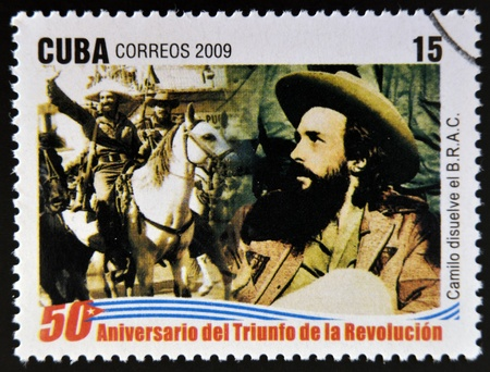 repression: CUBA - CIRCA 2009: A stamp printed in cuba dedicated to 50 anniversary of the triumph of the revolution, shows Camilo Cienfuegos dissolves the Bureau for the Repression of Communist Activities, circa 2009