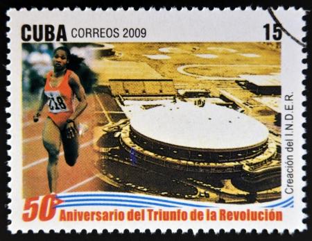 educacion fisica: CUBA - CIRCA 2009: Un sello impreso en Cuba dedicado al 50 aniversario del triunfo de la revoluci�n, muestra la creaci�n del Instituto Nacional de Deportes, Educaci�n F�sica y Recreaci�n, alrededor del a�o 2009