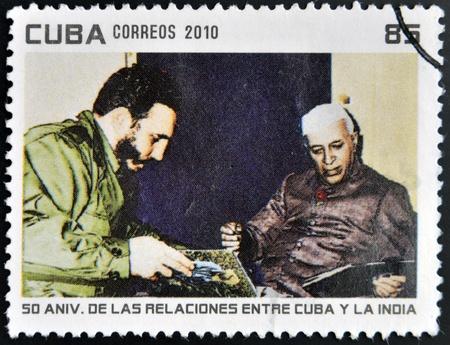 castro: CUBA - CIRCA 2010: A stamp printed in Cuba shows Fidel Castro and President of India, Rajendra Prasad, circa 2010 Editorial