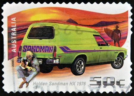 AUSTRALIA - CIRCA 2006: A stamp printed in Australia shows Holden Sandman HX - 1976 and man with guitar, circa 2006