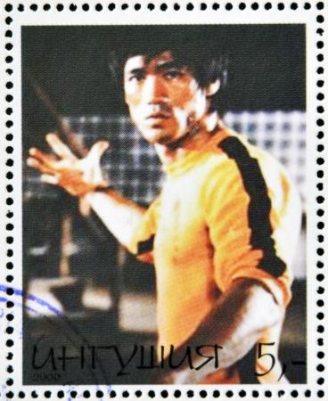 kungfu: REPUBLIC OF SAKHA (YAKUTIA) - CIRCA 2000: A stamp printed in Yakutia shows Bruce Lee, circa 2000