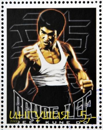 REPUBLIC OF SAKHA (YAKUTIA) - CIRCA 2000: A stamp printed in Yakutia shows Bruce Lee, circa 2000  Stock Photo - 21794224