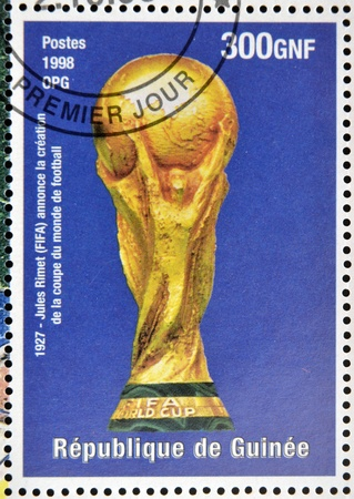 GUINEA - CIRCA 1998: a stamp printed in Republic of Guinea commemorating Jules Rimet (FIFA) announced the creation of the football world cup, circa 1998.