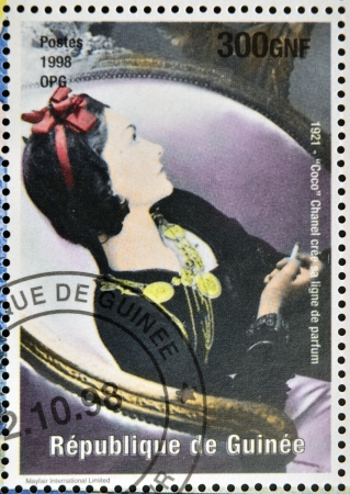 GUINEA - CIRCA 1998: a stamp printed in Republic of Guinea commemorating Coco Chanel created her perfume line, circa 1998. Editorial