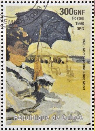 monet: GUINEA - CIRCA 1998: a stamp printed in Republic of Guinea commemorates the death of the painter Claude Monet, circa 1998. Editorial