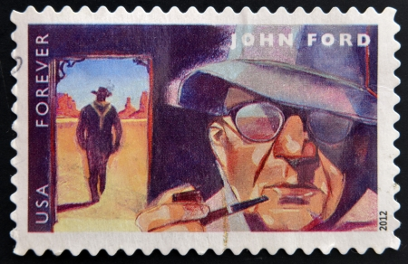 john wayne: UNITED STATES OF AMERICA - CIRCA 2012: A stamp printed in USA dedicated to the Great Film Directors First-Class Forever, shows John Ford, circa 2012