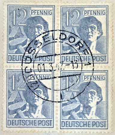 west of germany: GERMANY- CIRCA 1947: A stamp printed in West Germany (FRG) shows a Laborer in a hat, circa 1947