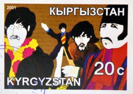KIRZIGUISTAN - CIRCA 2001:  stamp printed in Kirziguistan shows the Beatles, circa 2001