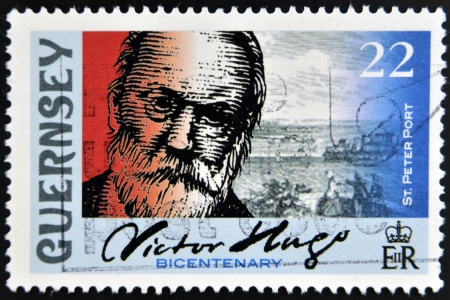 GUERNSEY - CIRCA 2002: A stamp printed in Guernsey shows Victor Hugo and St. Peter Port, circa 2002