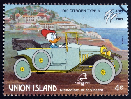 ST. VINCENT GRENADINES - UNION ISLAND - CIRCA 1989: A stamp printed in St. Vincent Grenadines shows Donald Duck, 1919 Citroen, circa 1989