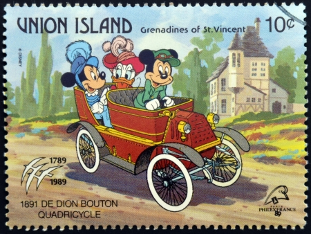 mickey: ST. VINCENT GRENADINES - UNION ISLAND - CIRCA 1989: A stamp printed in St. Vincent shows Mickey Mouse, Minnie Mouse and Daisy Duck, 1891 De Dion Bouton Quadricycle, circa 1989