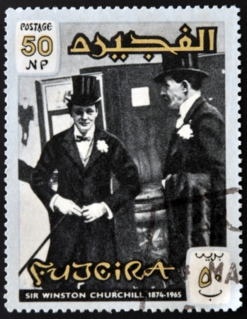 FUJERIA - CIRCA 1966: A stamp printed in Fujeira shows image of sir winston churchil, 1874-1965, circa 1966  Stock Photo - 22233819