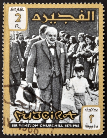 minister of war: FUJERIA - CIRCA 1966: A stamp printed in Fujeira shows image of sir winston churchil, 1874-1965, circa 1966