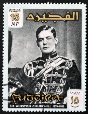 fujeira: FUJERIA - CIRCA 1966: A stamp printed in Fujeira shows image of sir winston churchil, 1874-1965, circa 1966