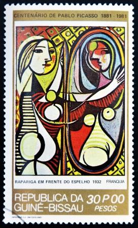 ギニア - 1981 年頃: およそ 1981 年パブロ ・ ピカソ、ギニアビサウ共和国で女の子の前に、ミラー印刷スタンプ