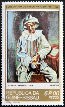 pablo: GUINEA - CIRCA 1981: A stamp printed in Republic of Guinea Bissau shows Pierrot Sitting by Pablo Picasso, circa 1981