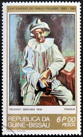 pablo: GUINEA - CIRCA 1981: Un timbro stampato nella Repubblica di Guinea-Bissau mostra Pierrot Sitting di Pablo Picasso, circa 1981