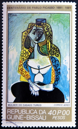 picasso: GUINEA - CIRCA 1981: A stamp printed in Republic of Guinea Bissau shows Jacqueline in turkish costume by Pablo Picasso, circa 1981 Editorial